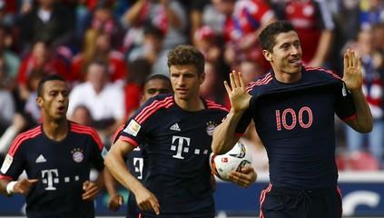 Robert Lewandowski of FC Bayern Munich celebrates his goal against FSV Mainz 05 during their German first division Bundesliga soccer match in Mainz