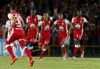 Meza of Colombia's Santa Fe celebrates with his teammates after scoring against of Argentina's Independiente during their Copa Sudamericana soccer match in Bogota