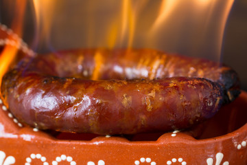 typical smoked portuguese sausage in ceramic dish