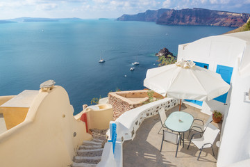 Santorini - The Oia and Therasia island in the background. Wall mural