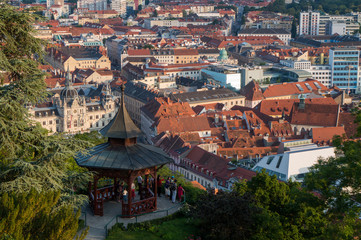 Graz, Austria - June 15th 2017: Tourists at a viewpoint overlooking the city of Graz