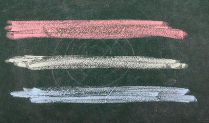 Three colorful lines on chalkboard, blackboard texture
