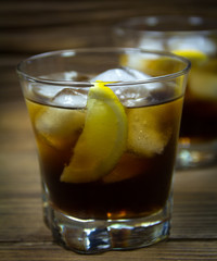 Cold Cola with ice and lemon in glasses