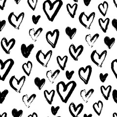 Seamless pattern with black hearts