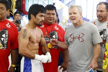 Boxer Manny Pacquiao stands with his trainer Freddie Roach after working out ahead of his bout with Tim Bradley, in Hollywood