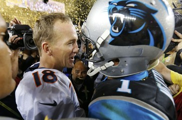 Denver Broncos' quarterback Manning and Carolina Panthers' quarterback Newton greet eachother on the field after the Broncos defeated the Panthers in the NFL's Super Bowl 50 football game in Santa Clara