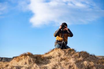 A  man taking a photo