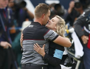 Sweden's Henrik Stenson kisses his wife Emma after winning the British Open golf championship at Royal Troon, Scotland
