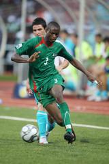 Burkina Faso's Mouhamed Ouattara gets past Turkey's Omer Ali Sahiner