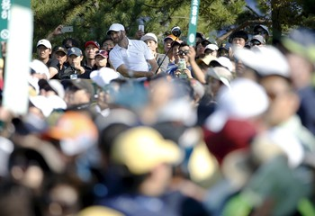 U.S. team member Johnson watches his tee shot on the 15th hole during the opening foursome matches of the 2015 Presidents Cup golf tournament at the Jack Nicklaus Golf Club in Incheon