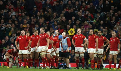 Wales team wait for a conversion kick after conceding a try to South Africa during their Rugby World Cup quarter-final at Twickenham in London