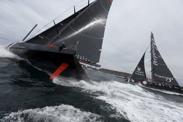 Maxi yachts Comanche and Perpetual Loyal race from Sydney Harbour into the Pacific Ocean during the 71st Sydney to Hobart Yacht race