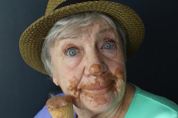 Happy senior woman eating ice cream