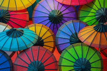 Colorful paper umbrellas on store shelves. Laos