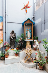 Mary statue with Saint Teresa of Calcutta statue in the Missionaries of Charity in Kolkata, India