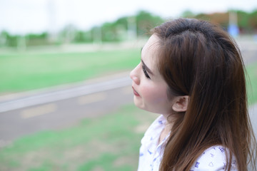 Beautiful woman is looking sky she think something in the park