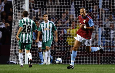 Aston Villa's John Carew (R) celebrates scoring their second goal