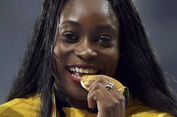 Athletics - Women's 100m Victory Ceremony