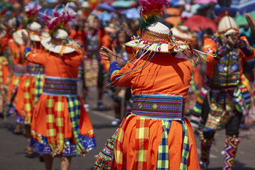 Tinkus dance group in colourful costumes performing a traditional ritual dance as part of the Carnaval Andino con la Fuerza del Sol in Arica, Chile.