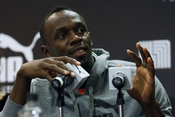 Jamaican sprinter Bolt touches the microphones to make a sound check as he speaks with journalists at a news conference during an event arranged by his sponsors in Mexico City