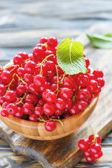 Bunches of red currant in a wooden bowl.