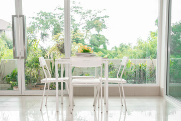 White table and chair for sit read book in the sunny day,relax,bright sunlight