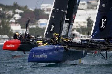 AC45F racing sailboat Artemis Racing (R) powers upwind ahead of Oracle Team USA during race 2 on their way to winning the America's Cup World Series sailing competition on the Great Sound in Hamilton