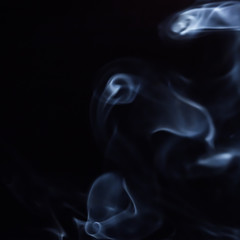 Abstract figure of bluish smoke on a dark background. A collection of square backgrounds and textures.