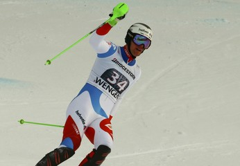 Gisin of Switzerland reacts in the finish following the men's Combined Alpine Skiing World Cup race in Wengen