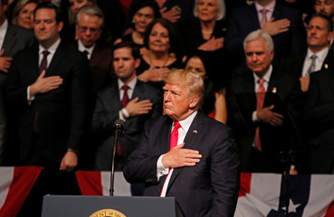 U.S. President Donald Trump reacts as Cuban violinist Luis Haza plays the Star Spangled Banner after Trump announced his Cuba policy at the Manuel Artime Theater in the Little Havana neighborhood in Miami