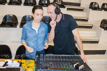 engineers working at mixing desk in recording studio