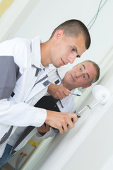 painter with apprentice and client