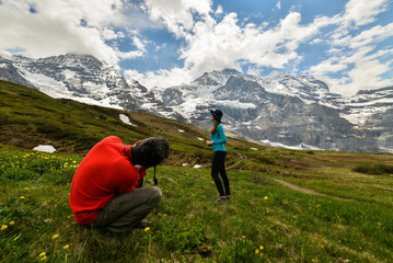 Activity sports. Hiking on a beautiful sunny summer day. Scenic panoramic landscape in the background