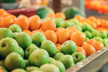 beautiful color combination, variety of fresh raw fruits background display at market stall