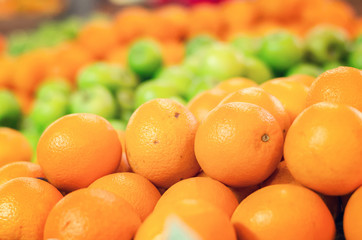 beautiful color combination, orange and green apple background display at market stall.