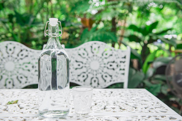 Water in bottle on the table for drink in the garden