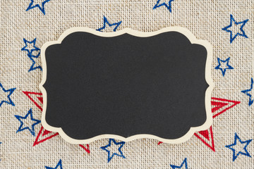 Chalkboard with USA red and blue stars on burlap background