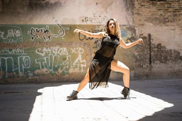 Pretty female dancer doing a dance routine
