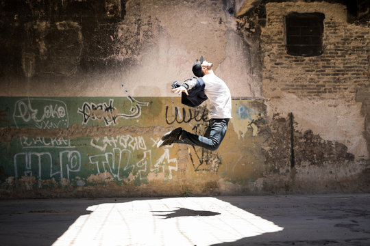 Hip hop dancer jumping and performing