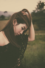 Beautiful thai woman very sad from unrequited love,rethink,think over,vintage style,dark tone,broken heart,asian girl,dam,bond,mountain