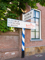 Old ANWB signpost in Woudrichem, Netherlands