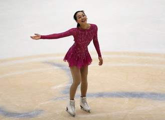 Asada of team Japan greets fans after performing during the ladies' singles short program during China ISU Grand Prix of Figure Skating , in Beijing