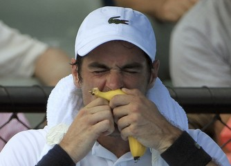 France's Chardy eats a banana during a break in his first round match against Latvia's Gulbis at the Australian Open tennis tournament at Melbourne Park, Australia