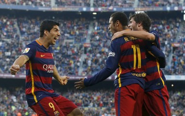 Barcelona's Suarez, Neymar and Roberto celebrate a goal against Villarreal during their Spanish first division soccer match at Camp Nou stadium in Barcelona