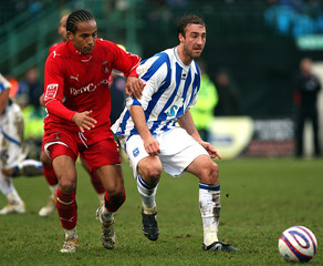 Glenn Murray (R) - Brighton & Hove Albion in action against Tamika Mkandawire - Leyton Orient