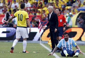 Colombia's coach Pekerman talks to player Rodriguez during their 2018 World Cup qualifying soccer match against Argentina in Barranquilla