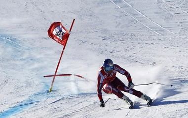 Svindal of Norway clears a gate during the men's Alpine Skiing World Cup Super G race on the Streif course in Kitzbuehel