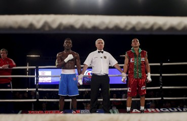 Muhammad Ali of British Lions Hearts and Mohammed Rabii of Morocco Atlas Lions wait for the final result of their WSB boxing flyweight title bout in Casablanca