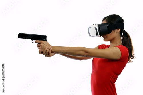 Young attractive woman in red shirt wearing virtual reality goggles