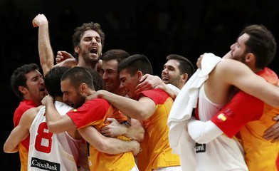 Spain's Paul Gasol and team mates celebrate victory over Greece at the end of their EuroBasket 2015 quarter-final game in Lille